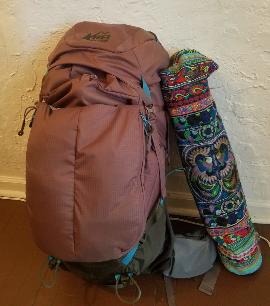 backpack and yoga mat