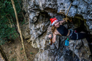 Climbing with a beer and a Santa hat